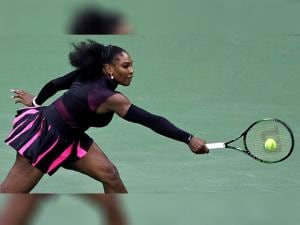 Serena Williams, of the United States, returns to Simona Halep