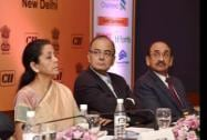 Finance Minister Arun Jaitley with MoS for Commerce and Industry Nirmala Sitharaman and CII President Ajay S Shriram