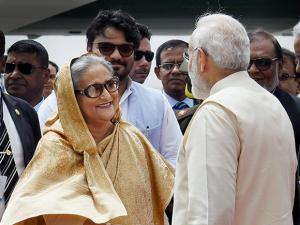 Prime Minister Narendra Modi welcomes Bangladesh PM Sheikh Hasina as she arrives at IGI Airport