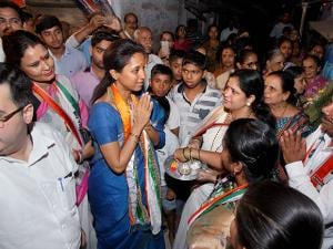 Nationalist Congress Party (NCP) MP Supriya Sule greets party members at an election rally in Thane