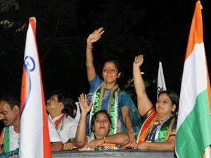 Nationalist Congress Party (NCP) MP Supriya Sule with party members at an election rally
