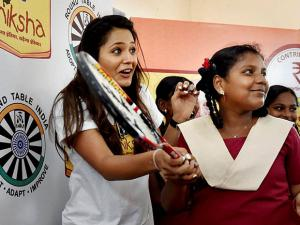 Dipika Pallikal playing with Shiksha School Students