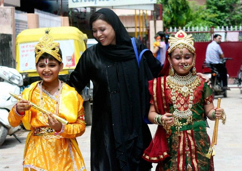 muslim woman, streets, Varanasi,kids, dressed, Lord Krishna, Radha, returning, competition, school, Janmashtami