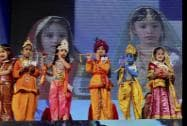 A child dressed up as Lord Krishna and radha participate in 'Bal Gopal' contest on the occasion of Janamashtami festival