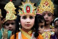 Kids dressed as Lord Krishna as they participate in a procession ahead of Janmashtami