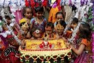 School children dressed as Gopi - Krishna and swing to idol of Lord Krishna ahead of Janmastami celebrations at a school