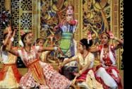 School children perform during a dance competition on the occasion of Srikrishna Janmastami
