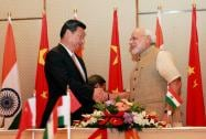 Prime Minister Narendra Modi shakes hands with the Chinese President Xi Jinping