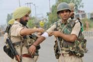 A security person gets injured in a clash with Sikh protesters