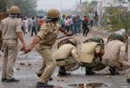 Police personnel in action against Sikh protesters