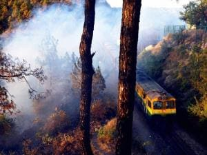 A Toy Train passes from the forest fire at Heritage Kalka Shimla Railway track near Taradevi, in Shimla