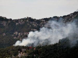 Smoke rises after a fire near ISBT in Shimla