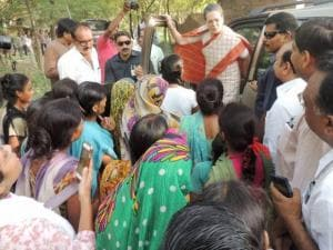Congress President Sonia Gandhi interact with people