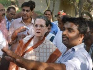 Congress President Sonia Gandhi visiting a village