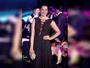 Mugdha Godse poses for photographers while walking the ramp at the Winter season fashion show