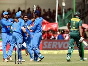 Indian cricketers celebrate the dismissal South African  Hashim Amla wicket