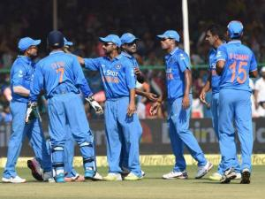 Indian cricketers celebrate the fall of South African batsman Quinton de Kock's wicket