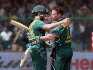 South African captain AB De Villiers  hugs Farhaan Behardien after his century