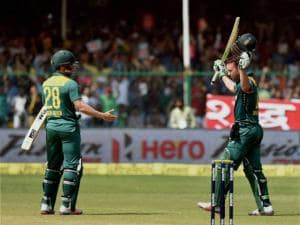 South African captain AB De Villiers with Farhaan Behardien celebrates after his century