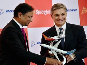 SpiceJet chairman Ajay Singh exchanges plane models with Raymond L Conner, Vice Chairman of Boeing Company