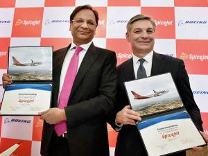 SpiceJet chairman Ajay Singh with Raymond L Conner, Vice Chairman of Boeing Company at a press conference to annouce a deal