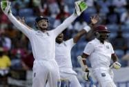 England's Jos Buttler successfully appeals for the wicket of West Indies' Devendra Bishoo