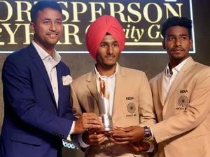 Indian Jr.hockey team captain Harjeet Singh being felicitated by Indian cricketer Pragyan Ojha