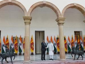 PM Narendra Modi shakes hands with his Sri Lankan PM Ranil Wickremesinghe