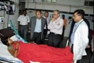 AIIMS doctors interact with one of the victims of Chhattisgarh's Sterlisation tragedy, at a hospital in Bilaspur