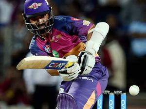 Ajinkya Rahane plays a shot during the IPL T20 match played against Mumbai Indians