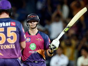 Rising Pune Supergiants batsman Steve Smith celebrates his half century during the IPL T20 match