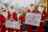 School student dressed as Santa Claus sends out a message protesting against Peshawar attacks