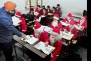 School students dressed up as Santa Claus during a fancy dress competition ahead of the Christmas Day celebrations