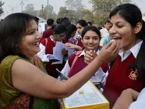 Teachers wish good luck to students at an examination centre before they appear for XII standard CBSE examinations in Gurgaon