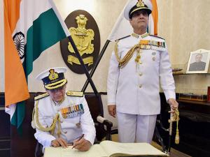 Admiral Sunil Lanba takes over as Indian Navy chief from R K Dhowan (standing), at South Block