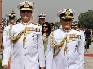 India's new Naval Chief, Admiral Sunil Lanba  and outgoing Navy Chief Robin K Dhowan inspect the Guard of Honour at a ceremony in South Block