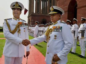 India's new Naval Chief, Admiral Sunil Lanba (on right)  shakes hand with outgoing chief Robin K Dhowan after inspects a Guard of Honour at South Block before taking over as the Chief of Naval Staff