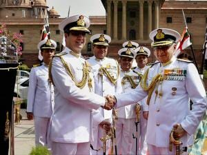 New Indian Navy chief Admiral Sunil Lanba and outgoing chief Robin K Dhowan shaking hand  before inspecting a Guard of Honour at a ceremony in South Block
