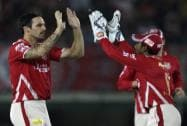 Mitchell Johnson of Kings XI Punjab and Wriddhiman Saha of Kings XI Punjab celebrate wicket of Ravi Bopara
