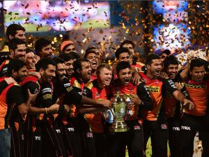 Sunrisers Hyderabad players celebrate with the winning trophy of IPL 2016 after beating Royal Challengers Bangalore in the final match at Chinnaswamy Stadium in Bengaluru