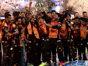 Sunrisers Hyderabad players celebrate with the winning trophy of IPL 2016 after beating Royal Challengers Bangalore in the final match at Chinnaswamy Stadium in Bengaluru (2)