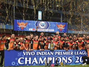 Sunrisers Hyderabad players celebrate with the winning trophy of IPL 2016 after beating Royal Challengers Bangalore in the final match at Chinnaswamy Stadium in Bengaluru (3)