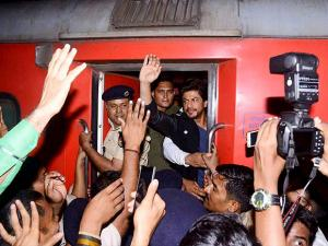Shah Rukh Khan waves to fans as he travels from Mumbai to Delhi in August Kranti Rajdhani Express
