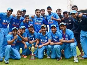 India'A' players pose with the trophy after they won the 3rd ODI series against Bangladesh