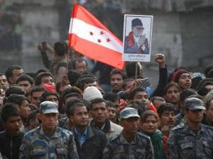 A supporter holds the Nepali congress Party flag during the cremation of Nepalese prime minister Sushil Koirala