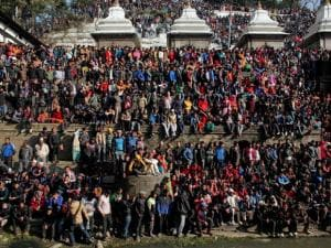 Nepalese people gather during the cremation of Nepalese prime minister Sushil Koirala, on the banks of the Bagmati River in Kathmandu