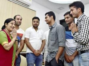 External Affairs Minister Sushma Swaraj exchanges greetings with Indian sailors
