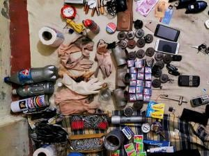 Arms, ammunition and other items recovered after suspected ISIS terrorist Saifullah