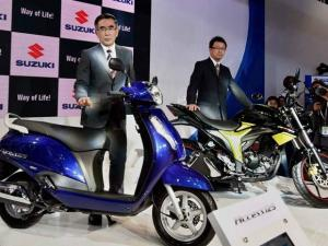 Suzuki Motorcycles officials pose with the company two-wheelers at their stall
