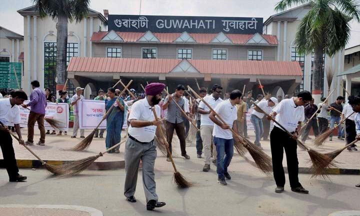 Employees, NF Railwaya, sweep, road,  part, Swachh Bharat Abhiyan